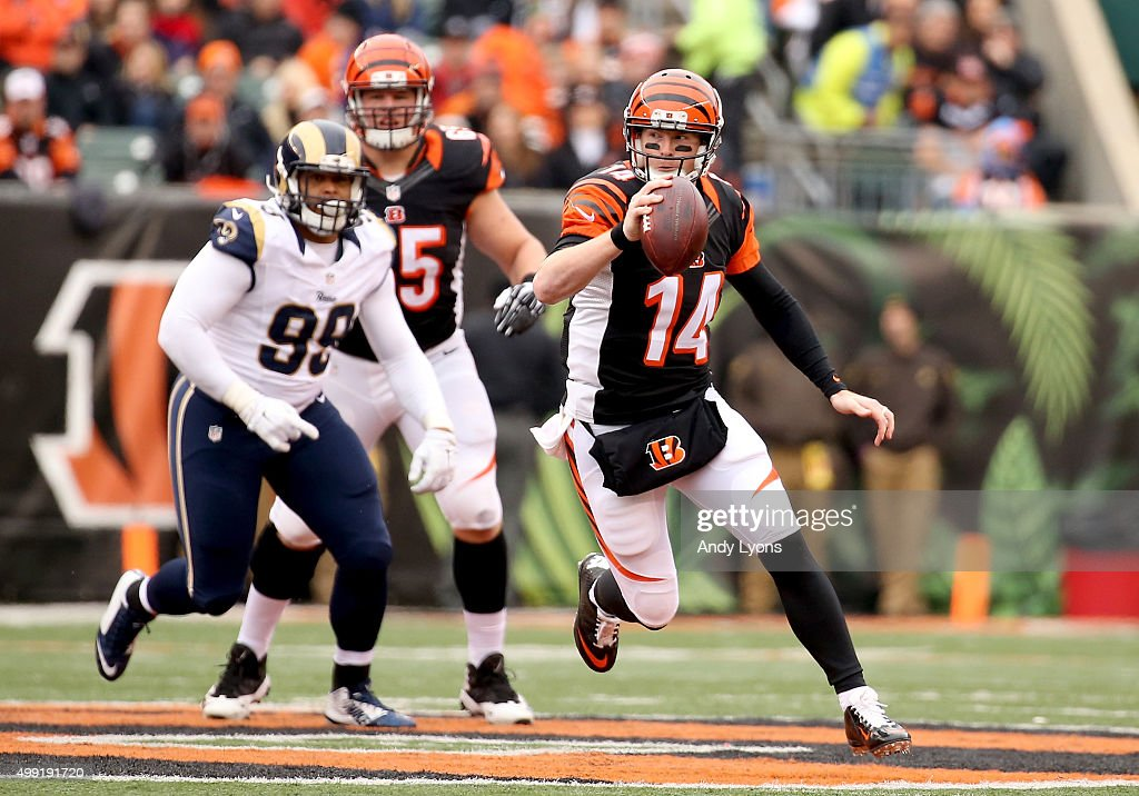 Andy Dalton #14 of the Cincinnati Bengals runs with the ball during the game against the St. Louis Rams at Paul Brown Stadium on November 29, 2015 in Cincinnati, Ohio.