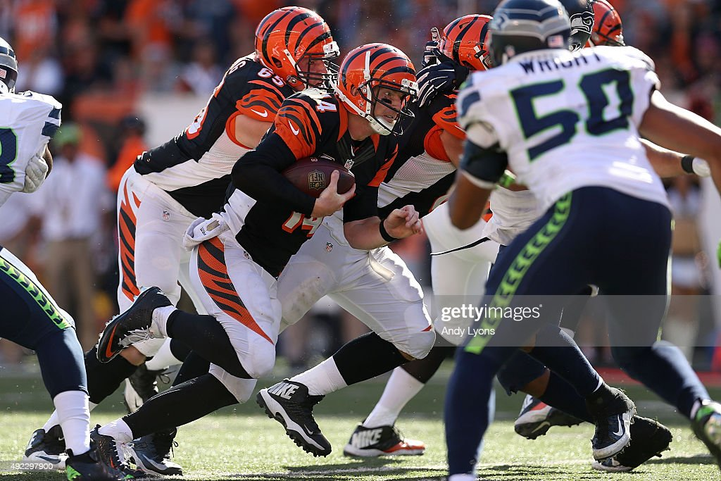 Andy Dalton #14 of the Cincinnati Bengals rushes for a touchdown during the fourth quarter of the game against the Seattle Seahawks at Paul Brown Stadium on October 11, 2015 in Cincinnati, Ohio. Cincinnati defeated Seattle 27-24 in overtime.