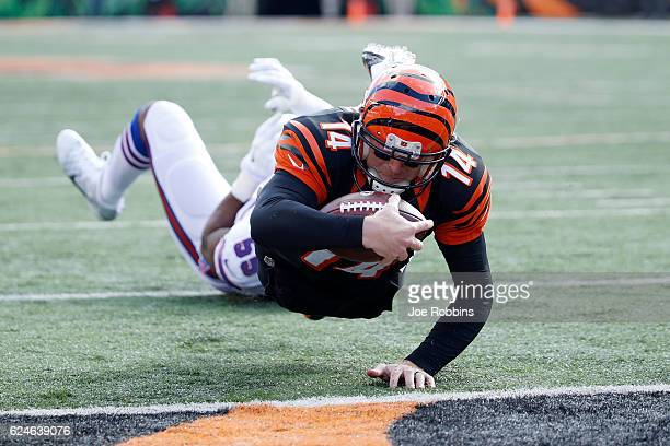 Andy Dalton of the Cincinnati Bengals scores a touchdown during the first quarter of the game against the Cincinnati Bengals at Paul Brown Stadium on...