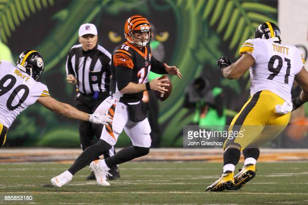 Andy Dalton of the Cincinnati Bengals scrambles away from TJ Watt and Stephon Tuitt of the Pittsburgh Steelers during the second half at Paul Brown...