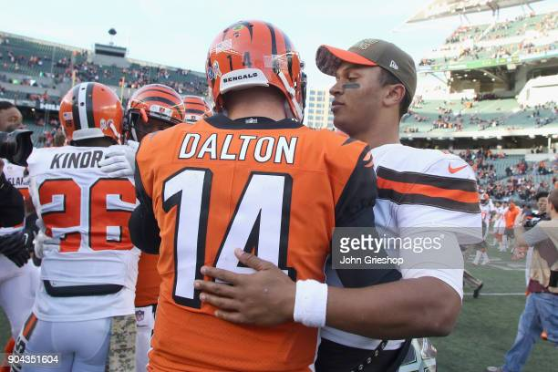Andy Dalton of the Cincinnati Bengals shares a moment with DeShone Kizer of the Cleveland Browns during their game at Paul Brown Stadium on November...