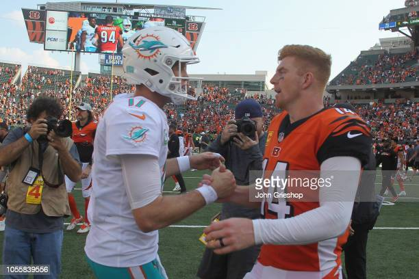 Andy Dalton of the Cincinnati Bengals shares a moment with Ryan Tannehill of the Miami Dolphins after their game at Paul Brown Stadium on October 7...