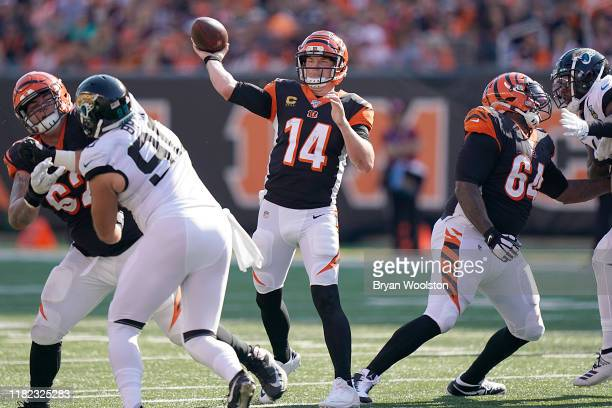 Andy Dalton of the Cincinnati Bengals throws the ball during the NFL football game against the Jacksonville Jaguars at Paul Brown Stadium on October...