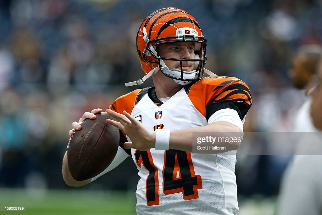 Andy Dalton #14 of the Cincinnati Bengals warms up against the Houston Texans during their AFC Wild Card Playoff Game at Reliant Stadium on January 5, 2013 in Houston, Texas.