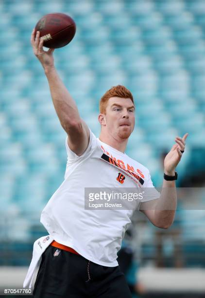 Andy Dalton of the Cincinnati Bengals works out on the field prior to the start of their game against the Jacksonville Jaguars at EverBank Field on...