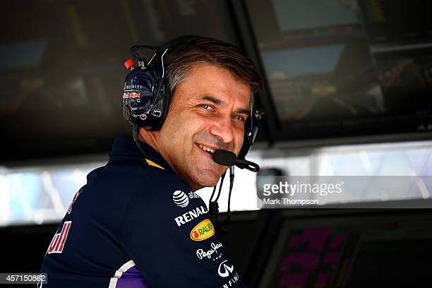 Andy Damerum of Infiniti Red Bull Racing smiles as he works on the pit wall during the Russian Formula One Grand Prix at Sochi Autodrom on October 12...