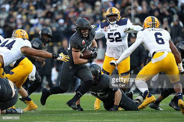 Andy Davidson of the Army Black Knights rushes the ball against the Navy Midshipmen in the first half at MT Bank Stadium on December 10 2016 in...