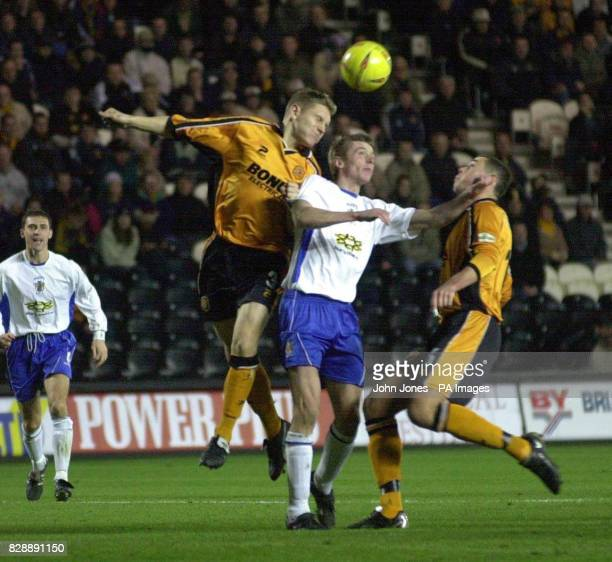 Andy Dawson of Hull goes for the header with Bury's Jo O'Neill, during the Nationwide Division Three match at the Kingston Communications Stadium,...