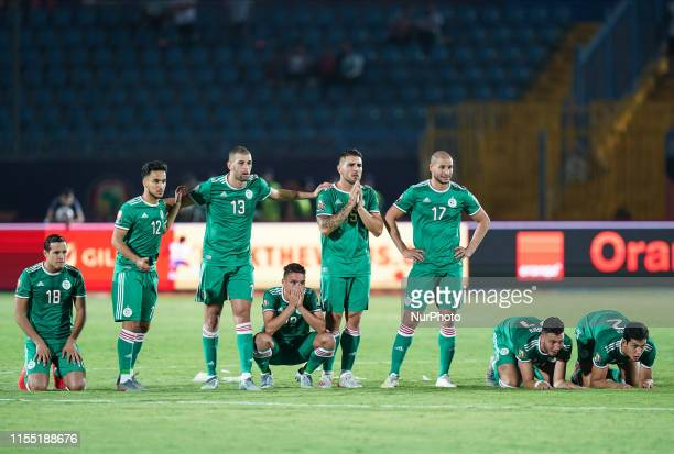 Andy Delort of Algeria praying with Algerian team during the 2019 African Cup of Nations match between Ivory coast and Algeria at the Suez Stadium in...