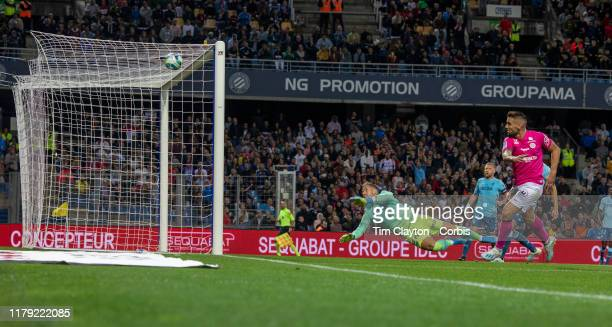 Andy Delort of Montpellier beats goalkeeper Benjamin Lecomte of Monaco to score his sides third goal during the Montpellier V Monaco French Ligue 1...