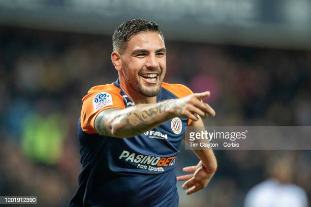 Andy Delort of Montpellier celebrates after scoring his sides second goal as he points to team mate Florent Mollet of Montpellier who provided the...