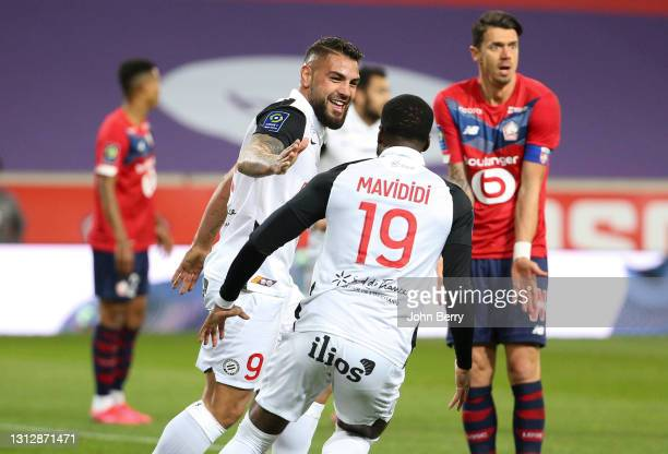 Andy Delort of Montpellier celebrates his goal with Stephy Mavididi of Montpellier while Jose Fonte of Lille looks dejected during the Ligue 1 match...