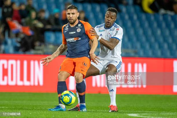 Andy Delort of Montpellier defended by Lamine Kone of Strasbourg during the Montpellier V Strasbourg French Ligue 1 regular season match at Stade de...