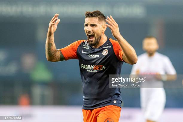 Andy Delort of Montpellier encourages the fans to get behind their side during the Montpellier V Nimes French Ligue 1 regular season match at Stade...