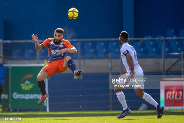 Andy Delort of Montpellier heads the ball watched by Alaixys Romao of Stade de Reims during the Montpellier Vs Stade de Reims French Ligue 1 regular...