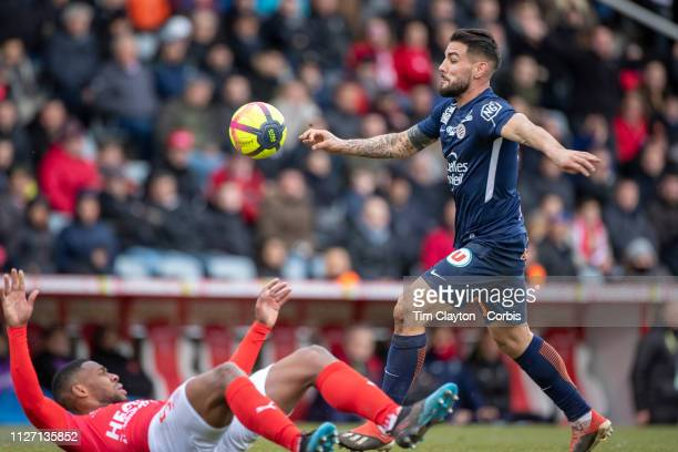 Andy Delort of Montpellier shoots watched by Loic Landre of Nimes during the Nimes V Montpellier French Ligue 1 regular season match at Stade des...
