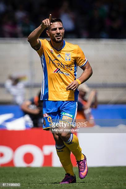 Andy Delort of Tigres celebrates after scoring his team's second goal during a match between Pumas UNAM and Tigres UANL as part of the Apertura 2016...