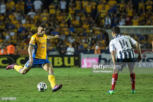 Andy Delort of Tigres kicks the ball while observed by Arturo Gonzalez of Monterrey during the 15th round match between Tigres UANL and Monterrey as...