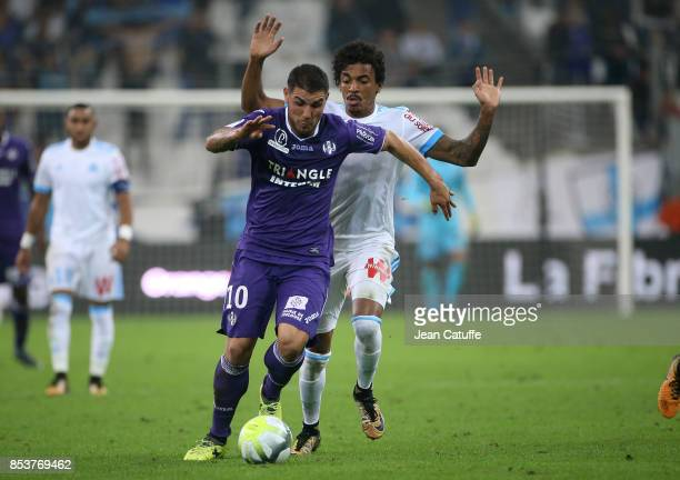 Andy Delort of Toulouse Luiz Gustavo of OM during the French Ligue 1 match between Olympique de Marseille and Toulouse FC at Stade Velodrome on...