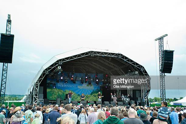 Andy Dinan Troy Donockley Adrian Edmondson and Tim Harries of Adrian Edmondson The Bad Shepherds perform on stage on the last day of Wychwood...