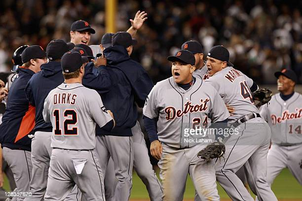 Andy Dirks, Miguel Cabrera, Victor Martinez of the Detroit Tigers and Austin Jackson of the Detroit Tigers celebrate after they won 3-2 against the...