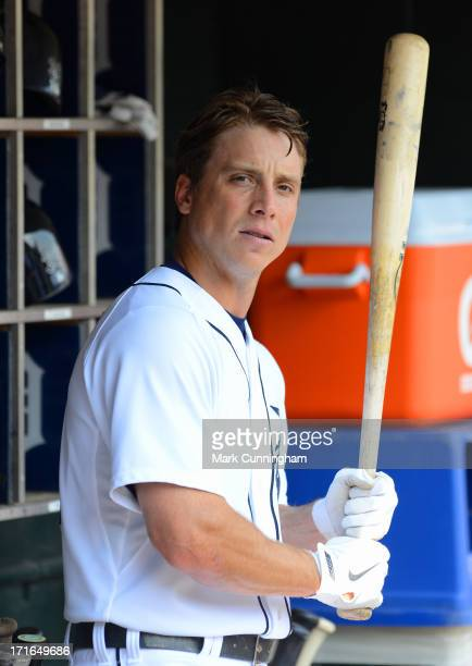 Andy Dirks of the Detroit Tigers looks on from the dugout during the game against the Boston Red Sox at Comerica Park on June 23 2013 in Detroit...