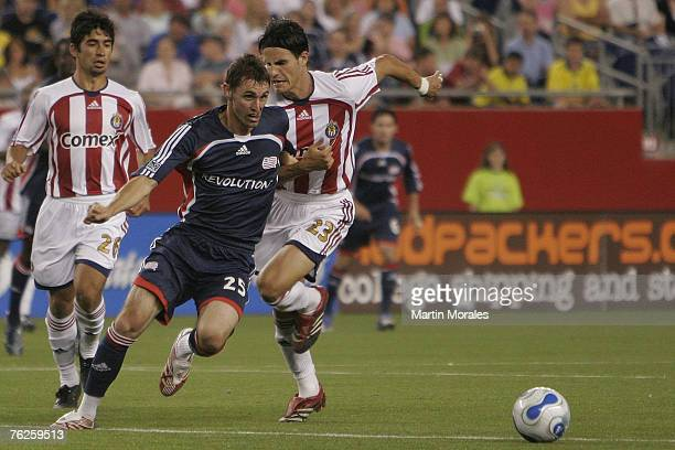 Andy Dorman is being chased by two defenders during MLS action on July 7, 2007 at Gillette Stadium in Foxborough, Massachusetts.The Revs tied with CD...