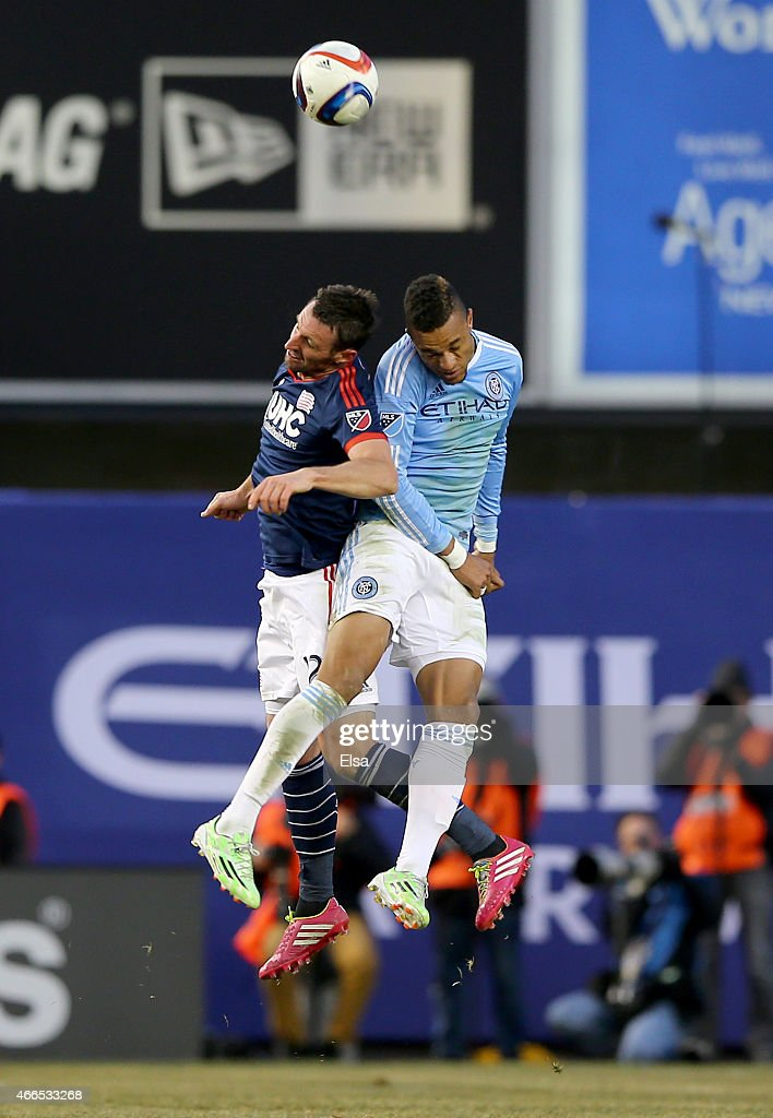 Andy Dorman #12 of New England Revolution and Khiry Shelton #19 of New York City FC head the ball during the inaugural game of the New York City FC at Yankee Stadium on March 15, 2015 in the Bronx borough of New York City.The New York City FC defeated the New England Revolution 2-0.