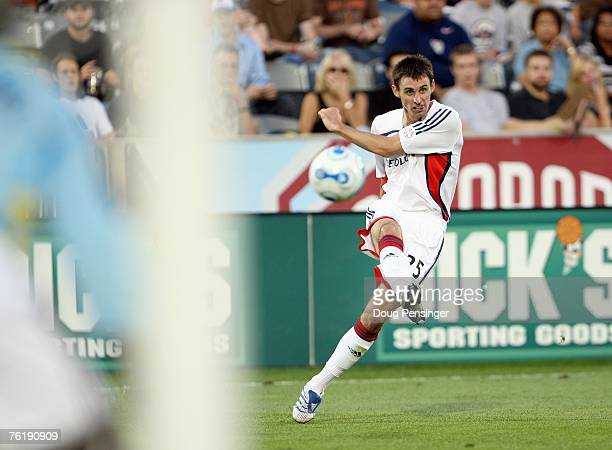 Andy Dorman of the New England Revolution kicks the ball toward the net en route to a 30 loss against the Colorado Rapids at Dick's Sporting Goods...