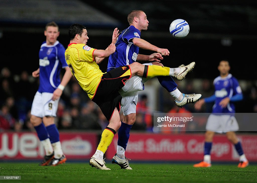 Andy Dury of Ipswich Town battles with Don Cowie of Watford during the npower Championship match between Ipswich Town and Watford at Portman Road on March 15, 2011 in Ipswich, England.