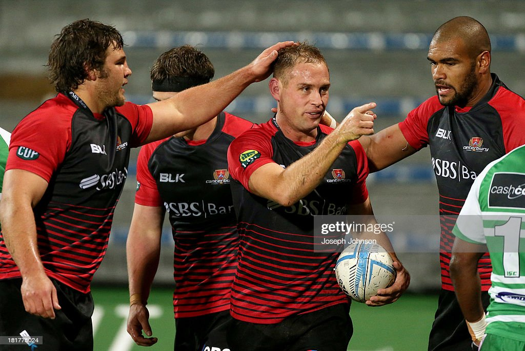 Andy Ellis of Canterbury is congratulated by Ben Funnell and Patrick Osborne after his try during the round 7 ITM Cup match between Canterbury and Manawatu at AMI Stadium on September 25, 2013 in Christchurch, New Zealand.