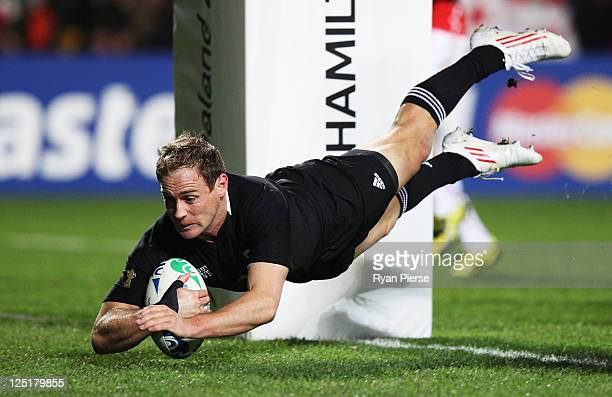 Andy Ellis of the All Blacks goes over to score his try during the IRB 2011 Rugby World Cup Pool A match between New Zealand and Japan at Waikato...