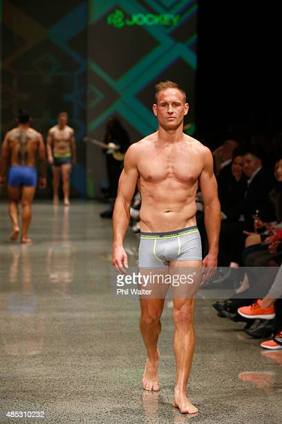 Andy Ellis of the All Blacks walks in the Jockey show at New Zealand Fashion Week 2015 on August 27 2015 in Auckland New Zealand