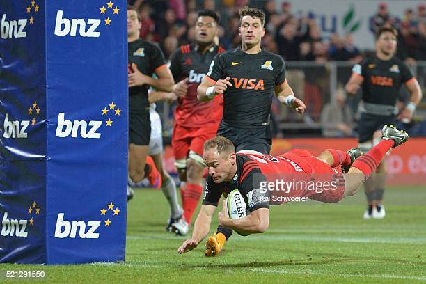 Andy Ellis of the Crusaders dives over to score a try during the round eight Super Rugby match between the Crusaders and the Jaguares at AMI Stadium...