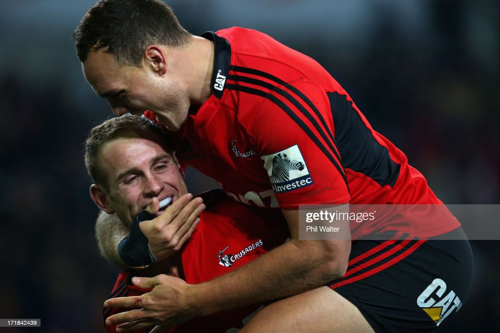 Andy Ellis of the Crusaders (L) is congratulated on his try by Israel Dagg (R) during the round 18 Super Rugby match between the Highlanders and the Crusaders at Forsyth Barr Stadium on June 29, 2013 in Dunedin, New Zealand.
