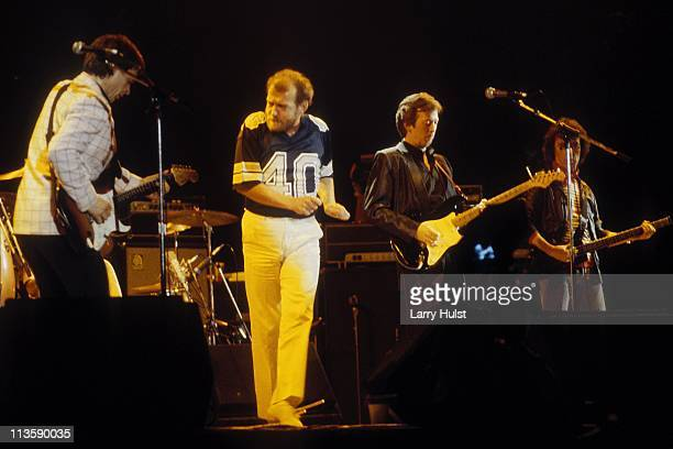 Andy Fairweather Low Joe Cocker Eric Clapton and Bill Wyman performing at The Cow Palace in Daly City California on December 3 1983
