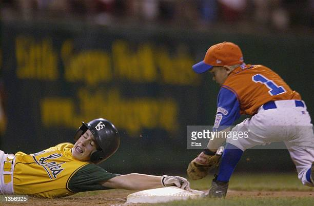 Andy Fallon of New England tries to tag out Zachary Osborne of the Great Lakes on August 24 2002 at Lamade Stadium in Williamsport The Great Lakes...
