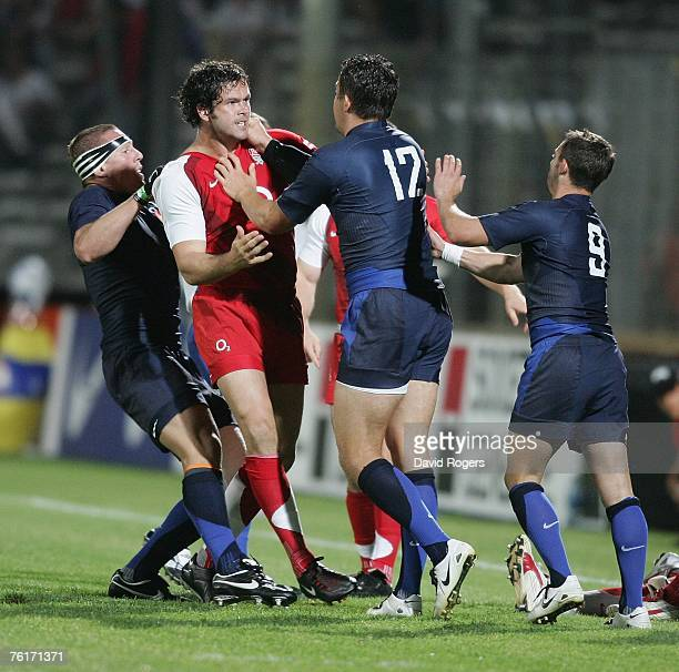 Andy Farrell of England exchanges blows with Damien Traille during the Rugby Union International match between France and England at Stade Velodrome...