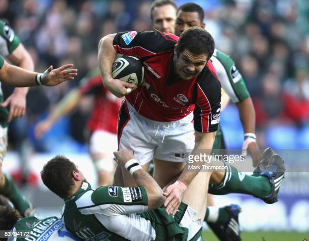 Andy Farrell of Saracens is tackled by Mike Catt of London Irish during the Guinness premiership match between London Irish and Saracens at The...