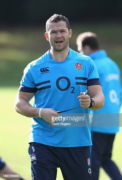 Andy Farrell the England backs coach issues instructions during the England training session held at Pennyhill Park on October 29 2013 in Bagshot...