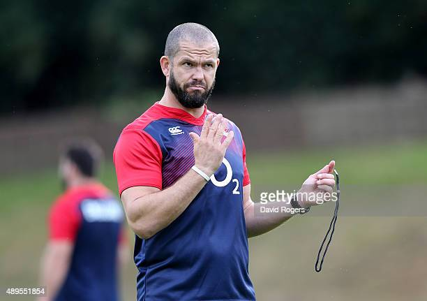 Andy Farrell the England backs coach issues instructions during the England training session at Pennyhill Park on September 22 2015 in Bagshot England