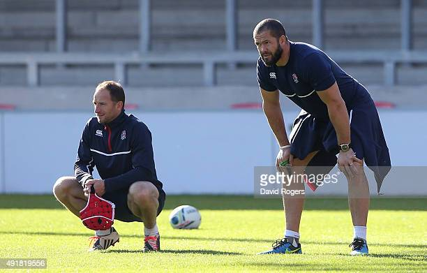 Andy Farrell the England backs coach looks on with skills coach Mike Catt during the England training session held at the AJ Bell Stadium on October...