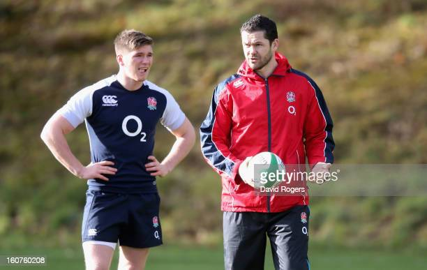 Andy Farrell the England backs coach talks to his son Owen Farrell during the England training session at Pennyhill Park on February 5 2013 in...