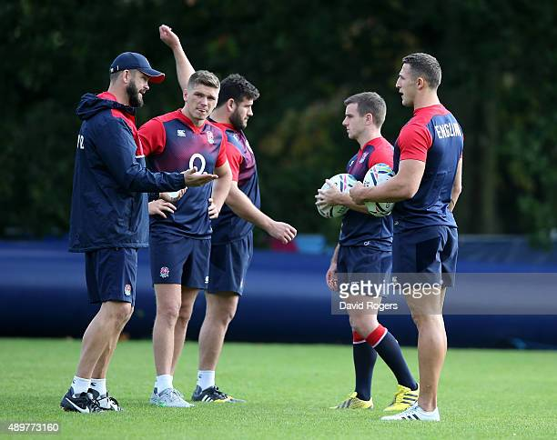 Andy Farrell the England backs coach talks to Owen Farrell George Ford and Sam Burgess during the England training session at Pennyhill Park on...