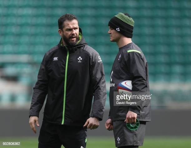 Andy Farrell the Ireland defence coach talks to Jonathan Sexton during the Ireland captain's run at Twickenham Stadium on March 16 2018 in London...