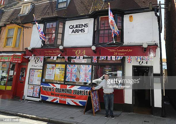 Andy Feest landlord of the Queens Arms in kemptown for twenty years poses after his pub is decorated inside and out with bunting flags and other...