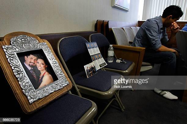 Andy Fernandez of South El Monte wipes a tear from his face at El Monte's city hall where a photo of slain El Monte City School Board member Roberto...