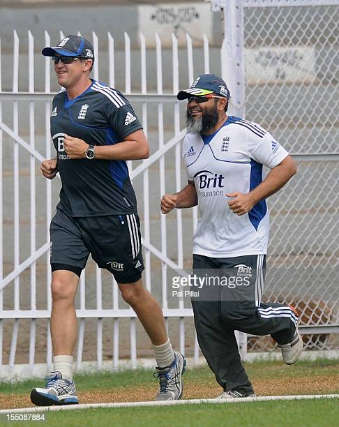 Andy Flower Team director of England and Mushtaq Ahmed bowling coach jog during the lunch break on the final day of the first practice match between...