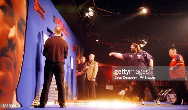 Andy Fordham at the ocky as Phil 'The Power' Taylor looks on during the headtohead showdown against at Circus Tavern Purfleet Fordham has the...