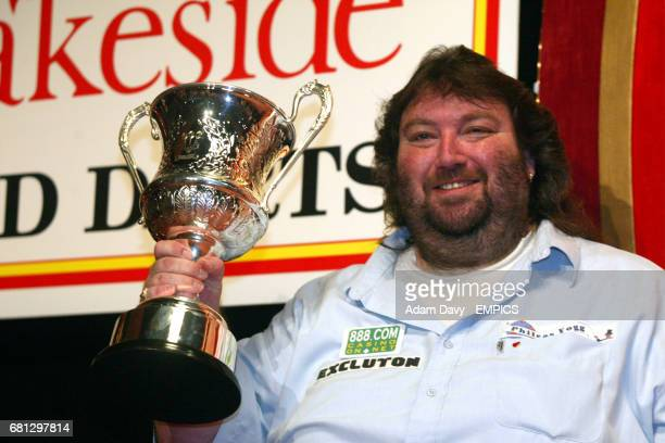 Andy Fordham celebrates with the trophy